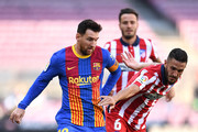 Lionel Messi of FC Barcelona battles for possession with Koke of Atletico de Madrid during the La Liga Santander match between FC Barcelona and Atletico de Madrid at Camp Nou on May 08, 2021 in Barcelona, Spain. Sporting stadiums around Spain remain under strict restrictions due to the Coronavirus Pandemic as Government social distancing laws prohibit fans inside venues resulting in games being played behind closed doors.