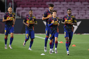 The players of Barcelona with Gerard Pique of FC Barcelona, Riqui Puig of FC Barcelona and Nelson Semedo of FC Barcelona warm up prior the Liga match between FC Barcelona and CA Osasuna at Camp Nou on July 16, 2020 in Barcelona, Spain.