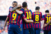 Daniel Alves and Jordi Alba of FC Barcelona congratulate his teammate Alexis Sanchez (2nd left) after scoring his team's second goal during the La Liga match between FC Barcelona and CA Osasuna at Camp Nou on March 16, 2014 in Barcelona, Spain.