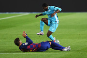 Gerard Pique of Barcelona is challenged by  Roger Assale of Leganes during the Liga match between FC Barcelona and CD Leganes at Camp Nou on June 16, 2020 in Barcelona, Spain.