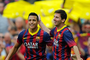 Alexis Sanchez of FC Barcelona celebrates with his teammate Lionel Messi of FC Barcelona after scoring the opening goal during the La Liga match between FC Barcelona and Club Atletico de Madrid at Camp Nou on May 17, 2014 in Barcelona, Spain.