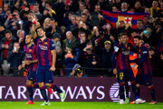 Luis Suarez of FC Barcelona celebrates close to his teammates Dani Alves, Neymar Santos Jr and Lionel Messi after scoring his team's second goal during the La Liga match between FC Barcelona and Club Atletico de Madrid at Camp Nou on January 11, 2015 in Barcelona, Spain.