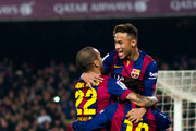 Neymar Santos Jr (top) of FC Barcelona celebrates with his teammates Dani Alves and Lionel Messi after scoring the opening goal during the La Liga match between FC Barcelona and Club Atletico de Madrid at Camp Nou on January 11, 2015 in Barcelona, Spain.