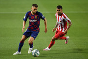 Jordi Alba (L) of FC Barcelona is challenged by Angel Correa of Atletico Madrid during the Liga match between FC Barcelona and Club Atletico de Madrid at Camp Nou on June 30, 2020 in Barcelona, Spain.