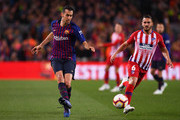Sergio Busquets of Barcelona beats Koke of Atletico Madrid during the La Liga match between FC Barcelona and  Club Atletico de Madrid at Camp Nou on April 06, 2019 in Barcelona, Spain.