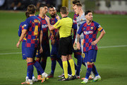 Luis Suarez of FC Barcelona and his team mates discuss with referee Alejandro Jose Hernandez Hernadez during the Liga match between FC Barcelona and Club Atletico de Madrid at Camp Nou on June 30, 2020 in Barcelona, Spain.