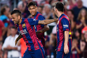 Lionel Messi of FC Barcelona celebrates with his teammates Neymar (L) and Dani Alves after scoring the opening goalduring the Joan Gamper Trophy match between FC Barcelona and Club Leon at Camp Nou on August 18, 2014 in Barcelona, Spain.