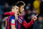 Alexis Sanchez (L) of FC Barcelona celebrates with his teammate Neymar after scoring his team's third goal from during the La Liga match between FC Barcelona and Granda CF at Camp Nou on November 23, 2013 in Barcelona, Spain.
