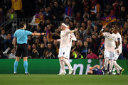 Referee Dr. Felix Brych points to the penalty spot as Phil Jones of Manchester United reacts during the UEFA Champions League Quarter Final second leg match between FC Barcelona and Manchester United at Camp Nou on April 16, 2019 in Barcelona, Spain.