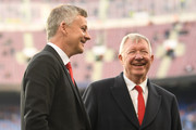 Sir Alex Ferguson speaks to Ole Gunnar Solskjaer, Manager of Manchester United on the pitch prior to the UEFA Champions League Quarter Final second leg match between FC Barcelona and Manchester United at Camp Nou on April 16, 2019 in Barcelona, Spain.