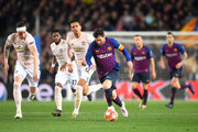 Lionel Messi of Barcelona runs with the ball while under pressure from Phil Jones of Manchester United during the UEFA Champions League Quarter Final second leg match between FC Barcelona and Manchester United at Camp Nou on April 16, 2019 in Barcelona, Spain.