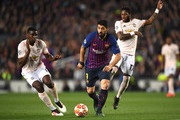 Luis Suarez of Barcelona runs with the ball as he is challenged by Fred of Manchester United and Paul Pogba of Manchester United during the UEFA Champions League Quarter Final second leg match between FC Barcelona and Manchester United at Camp Nou on April 16, 2019 in Barcelona, Spain.