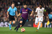 Luis Suarez of Barcelona runs with the ball away from Fred of Manchester United during the UEFA Champions League Quarter Final second leg match between FC Barcelona and Manchester United at Camp Nou on April 16, 2019 in Barcelona, Spain.