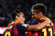 Alexis Sanchez (L) of FC Barcelona celebrates with his teammate Neymar of FC Barcelona after scoring the opening goal during the La Liga match between FC Barcelona and RCD Espanyol at Camp Nou on November 1, 2013 in Barcelona, Spain.