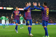 Lionel Messi (L) of FC Barcelona celebrates scoring with his teammate Alexis Sanchez during the la Liga match between FC Barcelona and Real Betis Balompie at the Camp Nou stadium on January 15, 2012 in Barcelona, Spain.