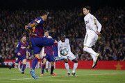 Luis Suarez of Barcelona takes on Sergio Ramos of Real Madrid during the Liga match between FC Barcelona and Real Madrid CF at Camp Nou on December 18, 2019 in Barcelona, Spain.