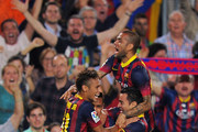 Alexis Sanchez (C) of FC Barcelona celebrates with Neymar (L) Dani Alves (R) and Xavi Hernandez  after scoring his team's 2nd goal during the La Liga match between FC Barcelona and Real Madrid CF at Camp Nou stadium on October 26, 2013 in Barcelona, Spain.