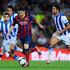 Lionel Messi Photos - Lionel Messi of FC Barcelona duels for the ball among Real Sociedad de Futbol players during the La Liga match between FC Barcelona and Real Sociedad de Futbol at Camp Nou on September 24, 2013 in Barcelona, Spain. - Lionel Messi Photos - 9176 of 13396