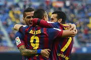 Alexis Sanchez of FC Barcelona celebrates after scoring with his teammates Pedro and Daniel Alves (L) during the La Liga match between FC Barcelona and Valencia CF at Camp Nou on February 1, 2014 in Barcelona, Spain.