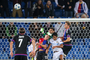 goalkeeper Juan Pablo of Tel Aviv makes a save Marek Suchy of Basel (C) during the UEFA Champions League qualifying round play off first leg match between FC Basel and Maccabi Tel Aviv at St. Jakob-Park on August 19, 2015 in Basel, Switzerland.