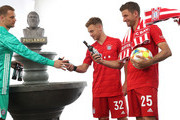 (L-R) Manuel Neuer, Joshua Kimmich and Thomas Mueller of FC Bayern Muenchen during the FC Bayern Muenchen and Paulaner photo session at FGV Schmidtle Studios on September 01, 2019 in Munich, Germany.