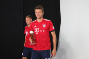Thomas Mueller (R) of FC Bayern Muenchen and his team mate Joshua Kimmich during the FC Bayern Muenchen and Paulaner Photo Session at FGV Schmidtle Studios on September 2, 2018 in Munich, Germany. .The traditional photo shoot featuring FC Bayern Muenchen for the Paulaner brewery who have been a platinum partner with Bayern Muenchen since 2003. Giving some of the stars from Germany?s record-breaking football team and their trainer Niko Kovac the opportunity to get in touch with some Bavarian culture by dressing for the shoot in Lederhosen the traditional attire of Bavaria.