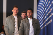 Serge Gnabry of FC Bayern Muenchen arrives with Niklas Suele and Thomas Mueller  for  the FC Bayern Muenchen and Paulaner Photo Session at FGV Schmidtle Studios on September 2, 2018 in Munich, Germany. .The traditional photo shoot featuring FC Bayern Muenchen for the Paulaner brewery who have been a platinum partner with Bayern Muenchen since 2003. Giving some of the stars from Germany?s record-breaking football team and their trainer Niko Kovac the opportunity to get in touch with some Bavarian culture by dressing for the shoot in Lederhosen the traditional attire of Bavaria.