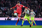 Thomas Muller #25 of Bayern Munich controls the ball next to Dominique Heintz #3 of 1.FC Koeln during the Bundesliga match between FC Bayern Muenchen and 1. FC Koeln at Allianz Arena on December 13, 2017 in Munich, Germany.