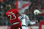Paul Pogba of Juventus and Arturo Vidal of Bayern Muenchen compete for the ball during the UEFA Champions League round of 16, second Leg match between FC Bayern Muenchen and Juventus at the Allianz Arena on March 16, 2016 in Munich, Germany.