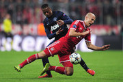 Patrice Evra of Manchester United tackles Arjen Robben of Bayern Muenchen during the UEFA Champions League Quarter Final second leg match between FC Bayern Muenchen and Manchester United at Allianz Arena on April 9, 2014 in Munich, Germany.
