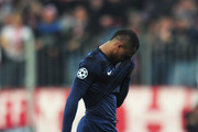 Patrice Evra of Manchester United leaves the field dejected after the UEFA Champions League Quarter Final second leg match between FC Bayern Muenchen and Manchester United at Allianz Arena on April 9, 2014 in Munich, Germany.
