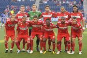 Members of the Chicago Fire pose for a starting 11 team photo before a match against the FC Dallas on May 27, 2010 at Toyota Park in Brideview, Illinois. Back Row,(L-R) Brian McBride #20, Andrew Dykstra #40, Baggio Husidic #9, C.J.Brown #2, Wilman Conde #22, Front Row (L-R): Justin Mapp #21, Mike Banner #18, Krzysztof Krol #23, Patrick Nyarko #14, Dasan Robinson #32, and Logan Pause #12. (Photo by David Banks/Getty Images).