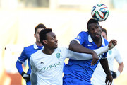 Douglas (R) of FC Dinamo Moscow challenged by Kanu of FC Terek Grozny during the Russian Premier League match between FC Dinamo Moscow and FC Terek Grozny at the Arena Khimki Stadium on November 23, 2014 in Khimki, Russia.