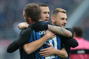 Ivan Perisic of FC Internazionale Milano (C) celebrates with his team-mate Davide Santon and Marcelo Brozovic (R) after scoring the opening goal during the Serie A match between FC Internazionale and AC Chievo Verona at Stadio Giuseppe Meazza on December 3, 2017 in Milan, Italy.