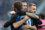 Ivan Perisic of FC Internazionale Milano (C) celebrates with his team-mate Davide Santon and Marcelo Brozovic after scoring the opening goal during the Serie A match between FC Internazionale and AC Chievo Verona at Stadio Giuseppe Meazza on December 3, 2017 in Milan, Italy.