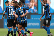 Danilo D Ambrosio of FC Internazionale celebrates his goal with his team-mate Alexis Sanchez and Ashley Young (R) during the Serie A match between FC Internazionale and Brescia Calcio at Stadio Giuseppe Meazza on July 1, 2020 in Milan, Italy.