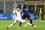 Romelu Lukaku of Inter Milan is tackled by Aaron Ramsey of Juventus  during the Serie A match between FC Internazionale and Juventus at Stadio Giuseppe Meazza on January 17, 2021 in Milan, Italy. Sporting stadiums around Italy remain under strict restrictions due to the Coronavirus Pandemic as Government social distancing laws prohibit fans inside venues resulting in games being played behind closed doors.