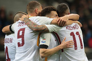 Stephan El Shaarawy (2nd R) of AS Roma celebrates with his team-mates after scoring the opening goal during the Serie A match between FC Internazionale and AS Roma at Stadio Giuseppe Meazza on January 21, 2018 in Milan, Italy.