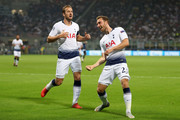 Christian Eriksen of Tottenham Hotspur celebrates with teammate Harry Kane after scoring his team's first goal during the Group B match of the UEFA Champions League between FC Internazionale and Tottenham Hotspur at San Siro Stadium on September 18, 2018 in Milan, Italy.