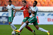 Roman Shishkin (L) of FC Lokomotiv Moscow is challenged by Kanu of FC Terek Grozny during the Russian Premier League match between FC Lokomotiv Moscow and FC Terek Grozny at Lokomotiv Stadium on April 19, 2014 in Moscow, Russia.