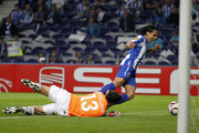 Radamel Falcao of FC Porto is fouled in penalty area by goalkeeper Diego Lopez of Villarreal during the UEFA Europa League semi final first leg match between FC Porto and Villarreal at Estadio do Dragao on April 28, 2011 in Porto, Portugal.