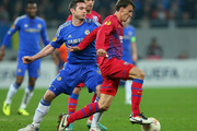 Frank Lampard of Chelsea battles with Vlad Chiriches of FC Steaua during the UEFA Europa League Round of 16 match between FC Steaua Bucuresti and Chelsea at the National Arena on March 7, 2013 in Bucharest, Romania.