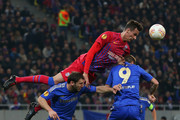 Lukasz Szukata of FC Steaua heads the ball over Branislav Ivanovic of Chelsea and Fernando Torres of Chelsea during the UEFA Europa League Round of 16 match between FC Steaua Bucuresti and Chelsea at the National Arena on March 7, 2013 in Bucharest, Romania.