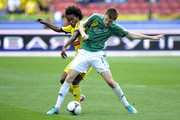 Oleg Ivanov (R) of FC Terek Grozny is challenged by Willian of FC Anzhi Makhachkala during the Russian Premier League match between FC Terek Grozny and FC Anzhi Makhachkala at the Akhmad-Arena Stadium on May 12, 2013 in Grozny, Russia.