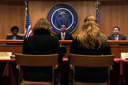 Federal Communications Commission Chairman Ajit Pai (C) and commission members Mignon Clyburn (L) and Michael O'Rielly (R) listen during a commission meeting December 14, 2017 in Washington, DC. FCC has voted to repeal its net neutrality rules at the meeting.