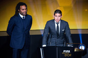 FIFA Puskas Award winner James Rodriguez of Colombia and Real Madrid speaks next to Christian Karembeu of France during the FIFA Ballon d'Or Gala 2014 at the Kongresshaus on January 12, 2015 in Zurich, Switzerland.
