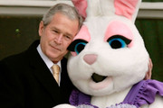 U.S. President George W. Bush (L) pauses to embrace a person dressed as the Easter Bunny during the annual Easter Egg Roll on the South Lawn of the White House March 24, 2008 in Washington, DC. The annual event was started by President Rutherford B. Hayes in 1878.