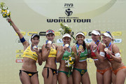 (L-R) Brazil's Barbara, Agatha, Larissa and Talita, Marleen Van Iersel, and Madelein Meppelink, from the Netherlands, pose for photos during the medal ceremony at the FIVB Beach Volleyball World Tour Rio Open at Copacabana beach on September 6, 2015 in Rio de Janeiro, Brazil. This event serves as a test for Rio 2016.