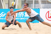 Martins Plavins(L) and Regza Haralds of Latvia in action during the match against Philip Dalhausser and Nicholas Lucena of USA during the FIVB Beach Volleyball World Tour Fuzhou Open on April 21, 2016 in Fuzhou, China.