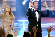 "Actress/singer Jennifer Lopez (L) and singer Harry Connick, Jr. greet fans onstage during FOX's ""American Idol"" Finale For The Farewell Season at Dolby Theatre on April 7, 2016 in Hollywood, California. at Dolby Theatre on April 7, 2016 in Hollywood, California."
